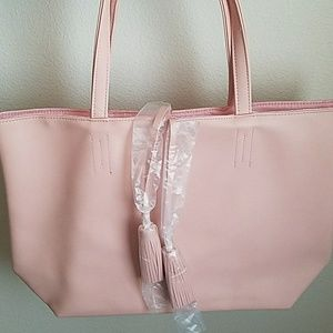 Handbags - New never used light pink tote bag w / tassle